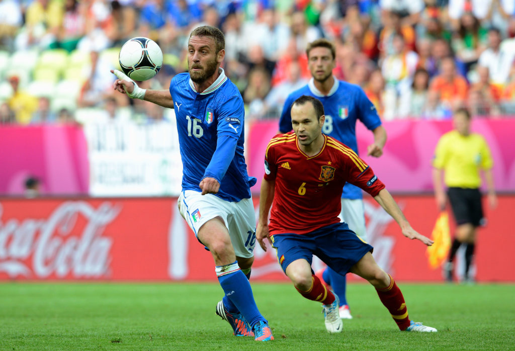 GDANSK, POLAND - JUNE 10: Daniele De Rossi of Italy and Andres Iniesta of Spain compete for the ball during the UEFA EURO 2012 group C match between Spain and Italy at The Municipal Stadium on June 10, 2012 in Gdansk, Poland. (Photo by Claudio Villa/Getty Images)
